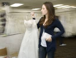 bridal consultant brides line up for free gowns at surf city shop orange