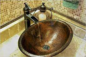 Bronze Faucets For Bathroom by Hand Hammered Copper Sinks And Bronze Faucets For Beautiful Rustic