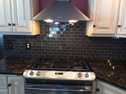 gorgeous kitchen backsplash with glass tile installed with urban