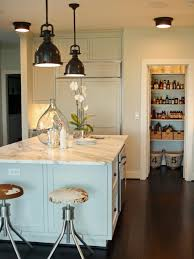 kitchen island with sink and dishwasher hanging pendant lights
