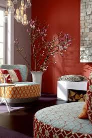 living room with hanging pendants and burgundy walls burgundy