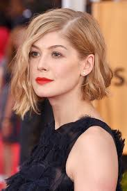 short haircuts behind the ears rosamund pike s short blonde wavy bob tucked behind one ear