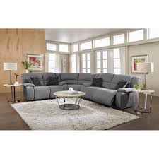 gray velvet sectional sofa in large living room with round white