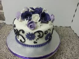 8 double layer cake with fondant icing and flowers with silver