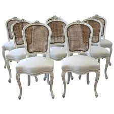 cane dining chairs gold coast wicker with arms india set room for