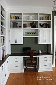 brown wooden office bookshelves nearby room fireplace below modern
