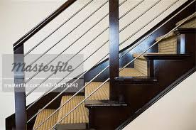 Metal Banisters Wooden And Metal Handrail Along Carpeted Staircase Stock Photo