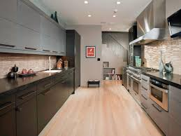 galley kitchen wooden cabinets warm up this galley style space and