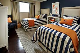 bedroom navy blue for accent wall with upholstered headboard and