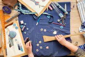 desk designer fashion fashion designer starts cutting fabric