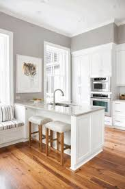 small kitchens designs wooden laminated flooring glass front upper