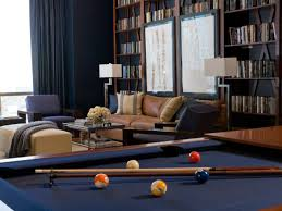 royal navy blue modern family room with a pool table and