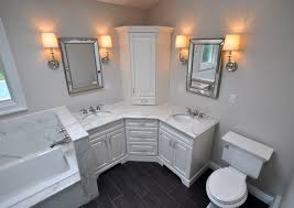 Bathroom Light Fixtures With Outlet by Custom Master Bathroom With Double Corner Vanity Tower Cabinet