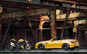mercedes motorcycle 2012 mercedes benz slk 55 amg and ducati streetfighter 848