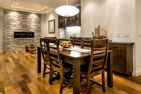 buffet table with fireplace hanging wine dining room transitional with wood floor wood sideboard