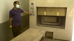cremation procedure cremation urn stock footage