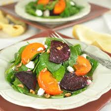 spinach salad with persimmons roasted beets goat cheese and a