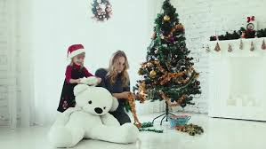 the snow maiden seating under a christmas tree with a dog the
