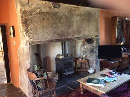 massive 16th century stone fireplace with modern wood burning