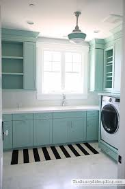 decorated and organized laundry room with color the sunny