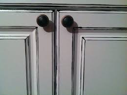 distressed white kitchen cabinets tiny distressed white kitchen cabinets with round black kitchen