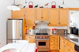 what to put on top of kitchen cabinets for decoration how to decorate the top of kitchen cabinets home design lover