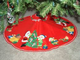 christmas tree skirts hooked on needles appliqued embroidered and beaded christmas