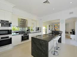 modern island kitchen designs the kitchen catalyst featuring caesarstone emperadoro island