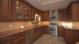 how to clean wood kitchen cabinets without damaging the finish caring for your wood cabinets c w appliance service
