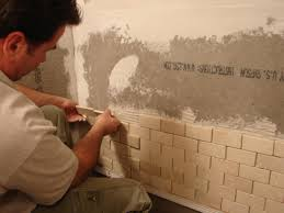 How To Install A Mosaic Tile Backsplash In The Kitchen how to install tile in a bathroom shower hgtv