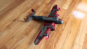 marx military aeroplane flying fortress mechanical tin windup toy