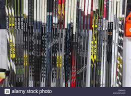 chicago blackhawks hockey sticks on their team bench during the