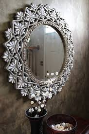 pier 1 round shell mother of pearl mirror in an entryway for