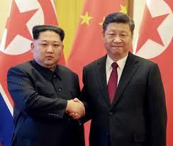 kim gives xi a nuclear pledge the standard