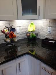 interior kitchen stone backsplash ideas with black countertop
