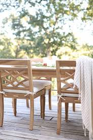 lake house deck with teak furniture how to decorate blogger julie blanner s lake house deck with ballard designs ceylon teak outdoor furniture