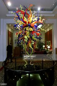 a dale chihuly s glass sculpture in the lobby of the hotel