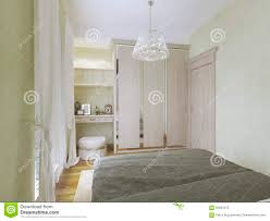 view of dressing table and wardrobe in modern bedroom stock photo
