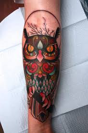 owl tattoo on forearm