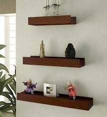 wall shelves pepperfry mango wood wall shelves set of 3 by home sparkle online wall