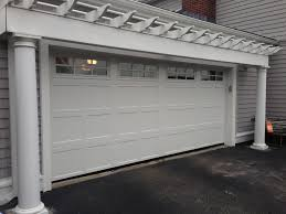 Graves Garage Doors by Haas Model 660 Steel Carriage House Style Garage Doors In White