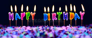 happy birthday candles happy birthday candles and party confetti isolated stock photo