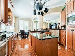 nice white wooden high end kitchen island featuring unique shape