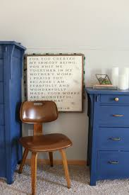 navy blue gray and gold master bedroom vintage bentwood chair with farmhouse art and blue dresser the dempster logbook