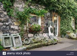 display of garden ornaments outside an antiques shop