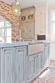 island kitchen and bath dove studio blue kitchen with exposed brick the blue