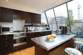 kitchen ideas for apartments appliances brown stained wooden cabinet metal countertop