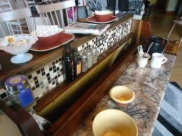 repurposed breakfast bar kitchen island with high back bar stools