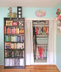 kid closet color coordinated bookshelf home of artist and