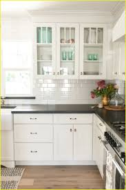 top white subway tile backsplash with dark grout small home